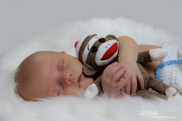 baby with sock monkey