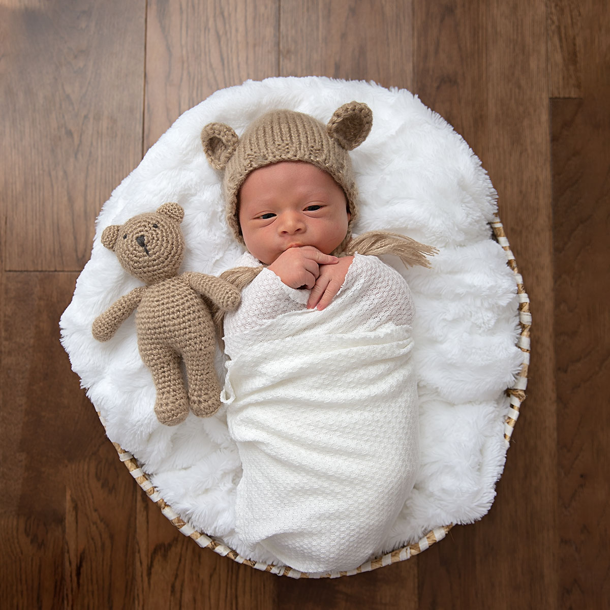 Photo of a newborn baby in a basket