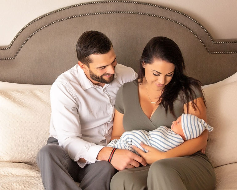 couple with newborn baby