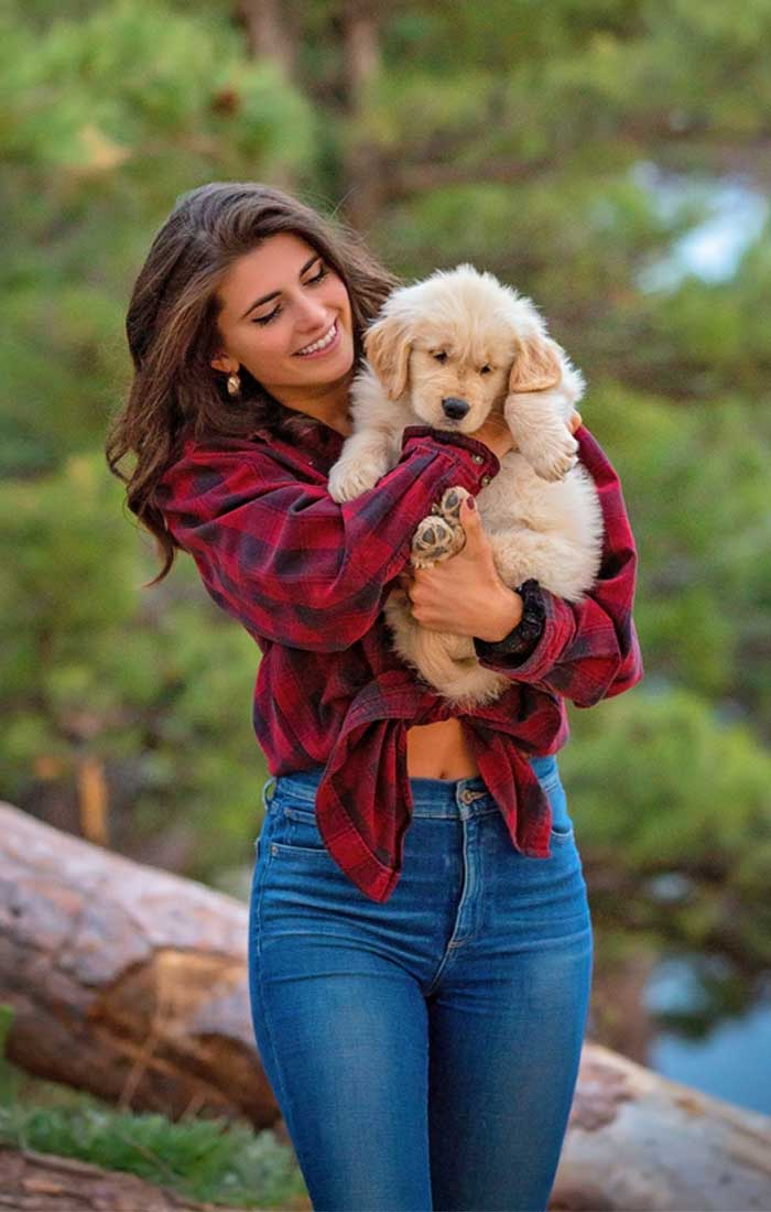 beautiful woman and puppy at Horsetooth Reservoir Fort Collins